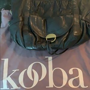 Kooba black shoulder bag with loads of pockets.